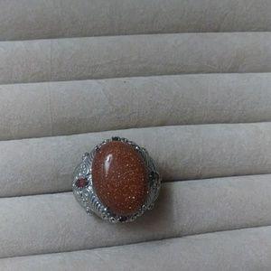 Gold stone garnet ring